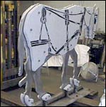 A 3000 lb mule sculpture in Stainless Steel, Granite and Rubber