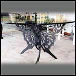 Another Butterfly table in steel and black paint