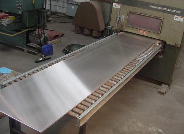 "5/8"" thick Stainless plate entering 1 of 2 polishing machines"