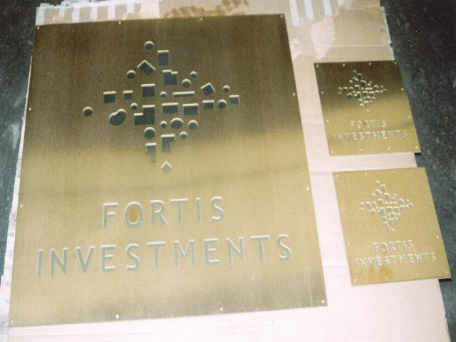 Fortis Investment archtectural signage in grained brass