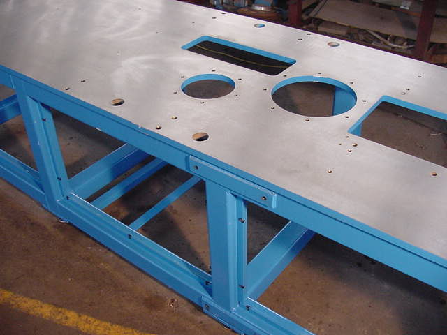 Machine base/table waterjet cut, fabricated, machined, stress-releived, sand-blasted, and painted